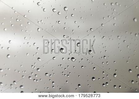 Drops of rain on the window (glass). Shallow DOF.