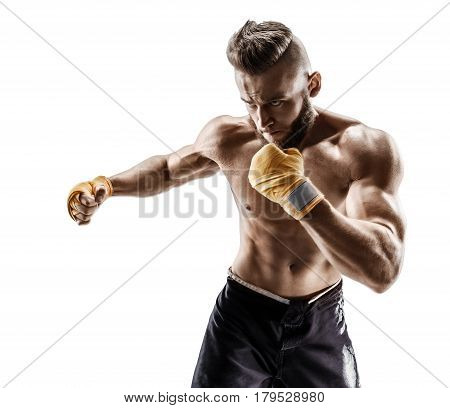 Boxer makes a long side kick - swing. Photo of muscular man on white background. Strength and motivation