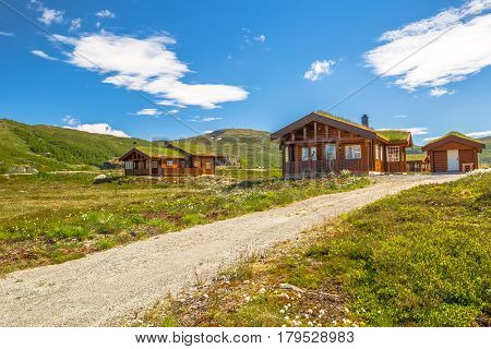 Mountan cabin houses with grass roof melding with the landscape and surrounding environment. Lofoten Islands, Norway.