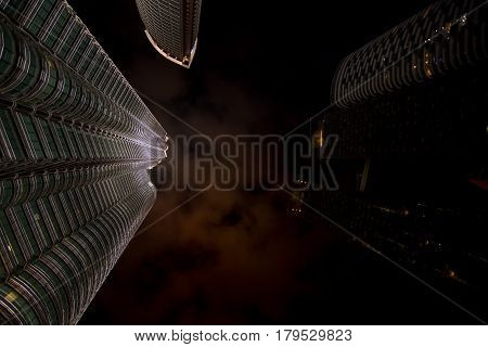 Petronas Twin Towers, Kuala Lumpur, Malaysia 10-09-2016.  Skywards View Of The Night Sky With Light