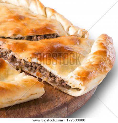 Close up Ossetian pie on wooden plate. Isolated on white with clipping path. Piece of meat ossetian pie.