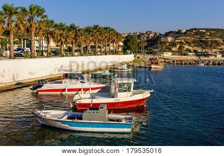 Kos island, Dodecanese, Greece - May 11, 2016: The promenade in Kefalos village with traditional fishing boats