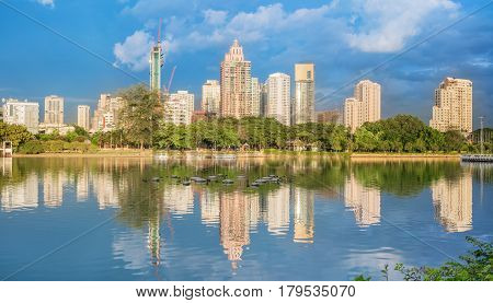 Citiscape Benchakitti park , green lung of Bangkok , in the evening with reflection , Thailand