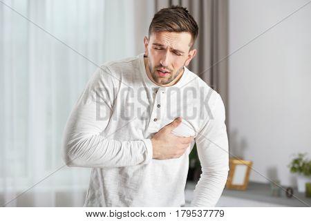 Man having a heart attack at home