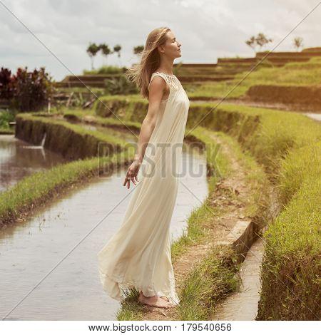 Beautiful woman in white dress. Rice terraces.