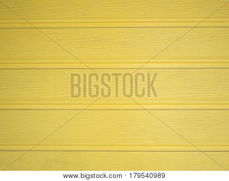 Bright Yellow-Painted Wood On Building. Bright Yellow-Painted Wood On Building.