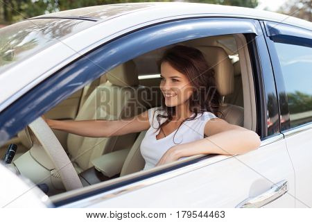 Young Happy Smiling Woman Driving Car