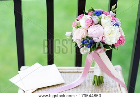 Peony and rose bridal bouquet and two wedding ring