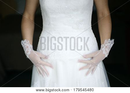 Bride white dress and gloves in wedding day