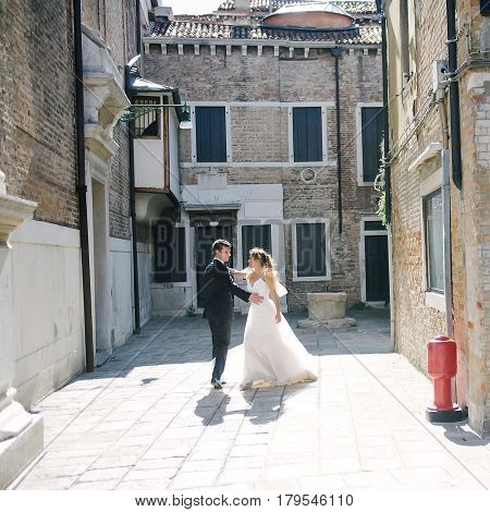 Young couple bride and groom dancing in Venice Italy