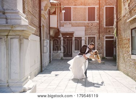 Bride and groom dancing in Venice in wedding day Venezia Italy