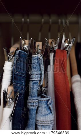 Various Clothes Hanged In Wardrobe