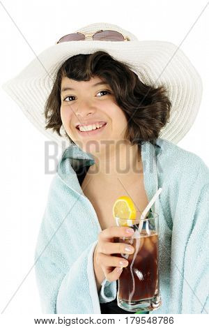 A pretty Hispanic teen in bathing suit, towel and big sun hat happily carrying a glass of iced tea.  On a white background.