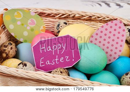 Greeting card and Easter basket. Eggs and colorful paper cutouts. Tips for Easter.