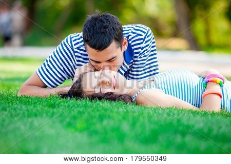 Photo Of Cute Couple Kissing And Lying On The Grass In The Field