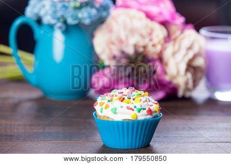 Photo Of Tasty Glazed Donut On The Wonderful Flowers In Vases Background