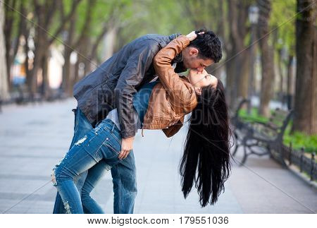 Photo Of Cute Couple Kissing And Hugging On The Wonderful Park Background