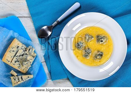 Polenta Porridge With Butter And Grated Cheese