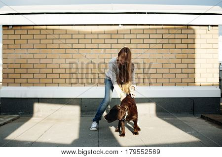 Young Woman Playing With Her Dog Labrador