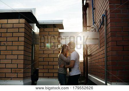 Sunny Outdoor Portrait Of Happy Couple