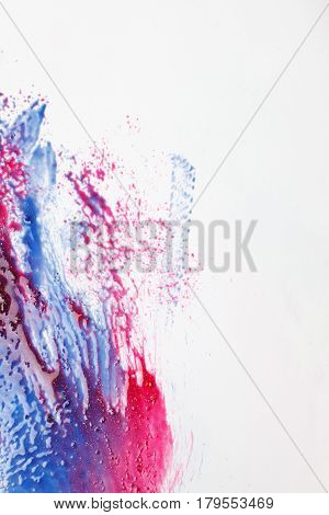 Creativity, abstractionism, abstract modern art, creative painting. Blue and red color mix on white background with free space.