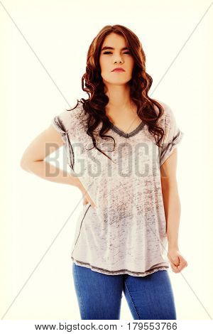Angry young woman with clenches fist