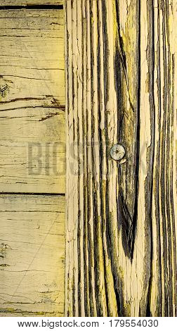 abstract wooden background with metal screw dark cracks a pronounced wood pattern yellow