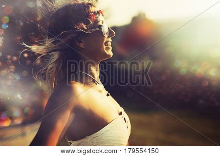 Beautiful hipster woman enjoying summer vaction and freedom