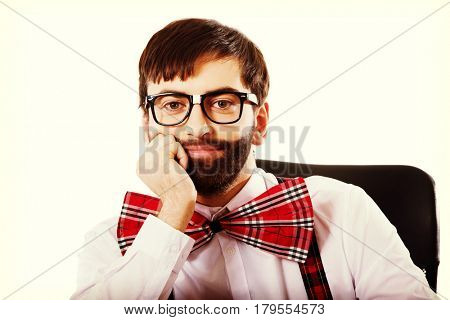 Young old fashioned man sitting by a desk.