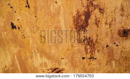 abstract background and texture rust orange-brown colored with spots