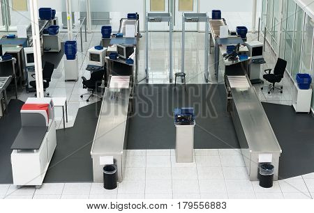 Airport security check point in passenger terminal.