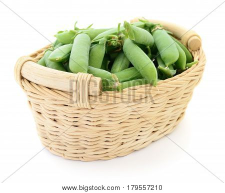 Fresh green peas in basket on a white background.