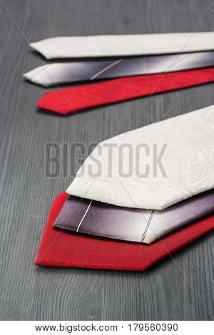 Tie on a dark wooden surface. tie