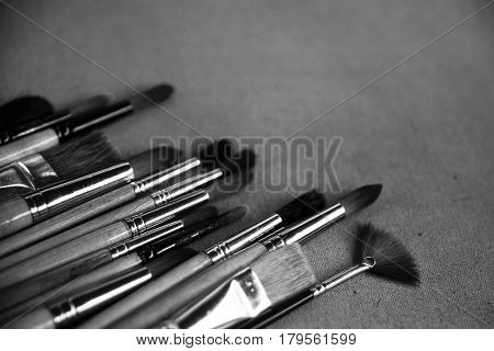 Lots Of Paintbrushes On Canvas Background
