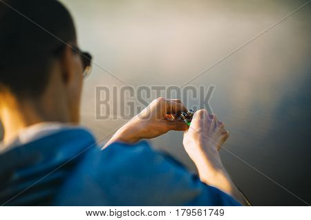 Hands Angler On A River With A Catch Spring