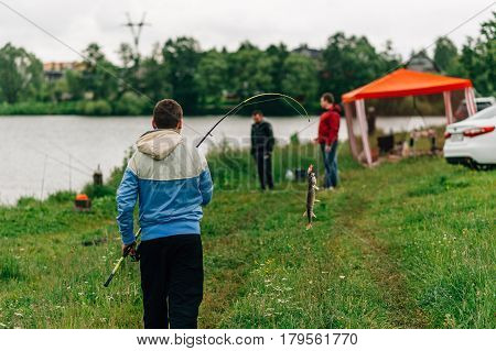 Angler On A River With A Catch Spring