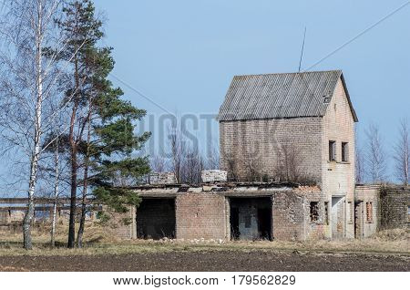 An old abandoned building on a abandoned farmstead.
