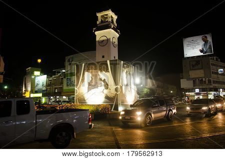 Landscape And Cityscape With Traffic Road With Ancient Clock Tower Roundabout Of Lampang City In Nig