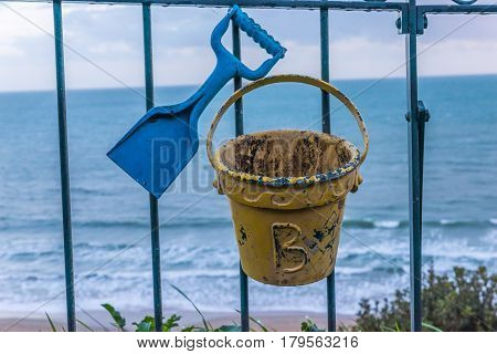 Metal Ornament On A Balustrade In A Seaside Village, A Symbolic Element In The Shape Of A Spade And