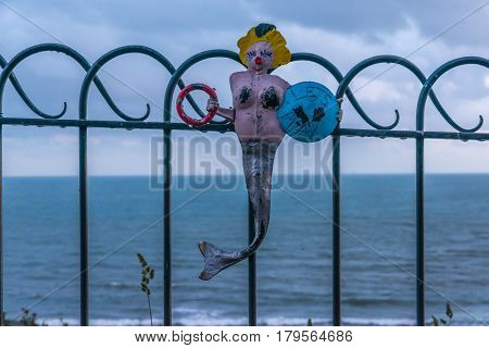 Metal Ornament On A Balustrade In A Seaside Village, Symbolic Element In The Shape Of A Mermaid