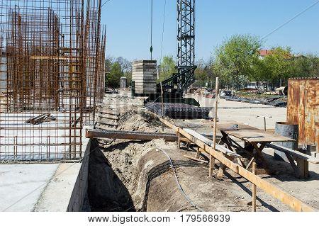 Construction Site against blue sky. Concrete blocks armature