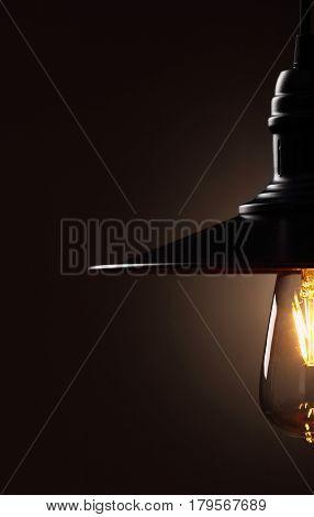 Industrial pendant lamps against wall. Loft interior. Edison bulbs.