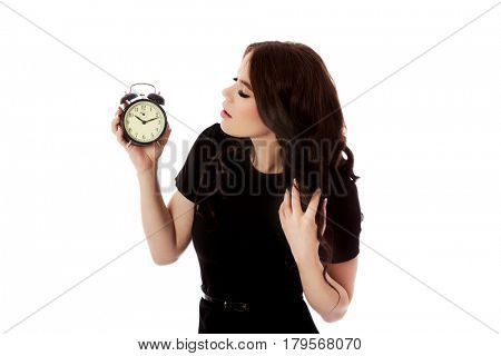 Young woman with alarmclock, isolated.