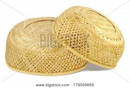 two inverted wicker basket material straw light yellow color small basket lies on big basket isolated on white background
