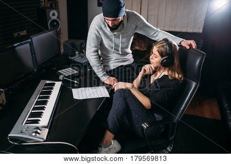 Female singer listen song record in music studio