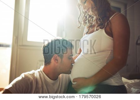 Beautiful couple in love awaiting baby with happiness
