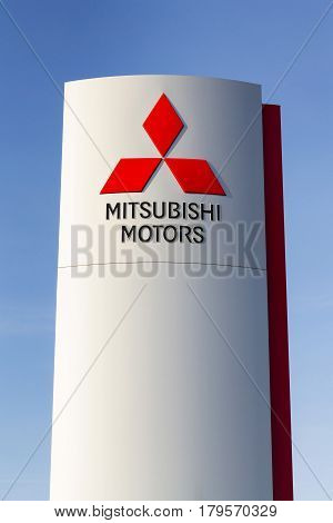 Prague, Czech Republic - March 31: Mitsubishi Motors Company Logo In Front Of Dealership Building On