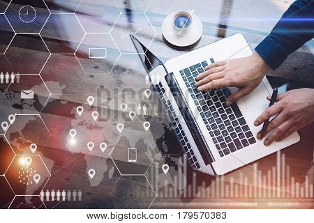 Concept of digital screen, virtual connection icon, diagram, graph interfaces.Man working with laptop at office at wooden table.Reflections on glass surface.Flares effect.Horizontal