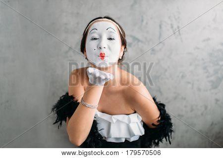 Pantomime theater actress posing in studio
