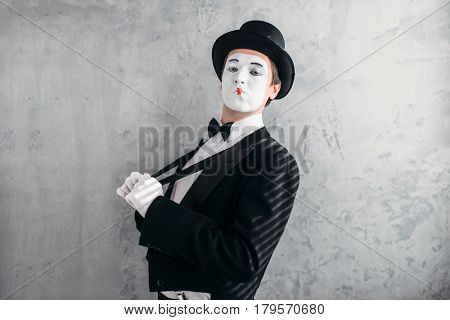 Mime male artist with white makeup mask